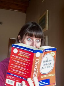 Aww, a girl and her dictionary.